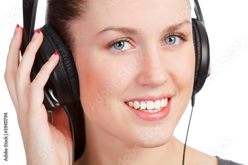 Pretty girl listening music and smiling to you