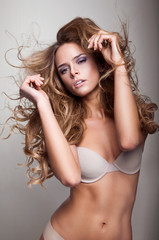 Beautiful delicate woman with long hair in motion
