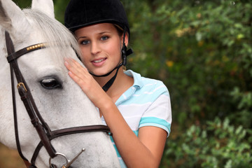 A cute blond and her horse.