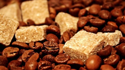 Grains of coffee and pieces of reed sugar