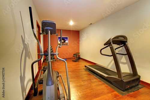 Modern home gym in the basement.