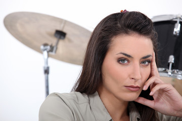 beautiful brunette with drums in background