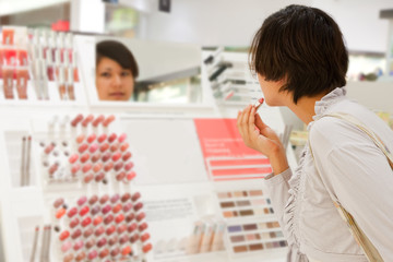 woman is choosing lipstick