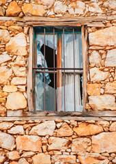 Window in an old house near lake Prespa in Northern Greece