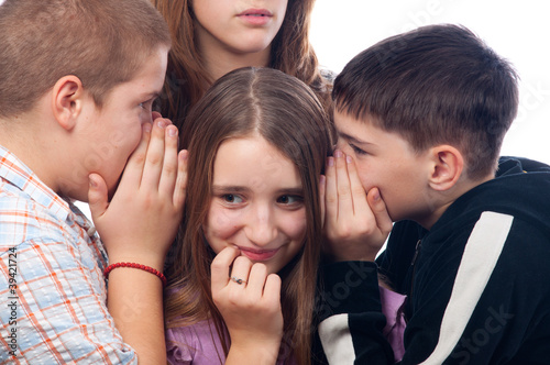 Teenages gossiping about their mutual friend