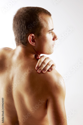 Young man holding on shoulder