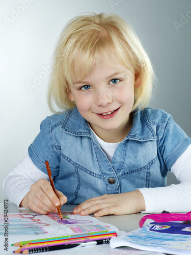 Cute blonde enjoys to paint a picture for art lessons