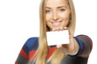 Female holding credit card, shallow depth of field