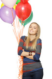 Smiling woman holding balloons against white background