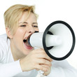 Pretty blonde woman shouting loud through megaphone