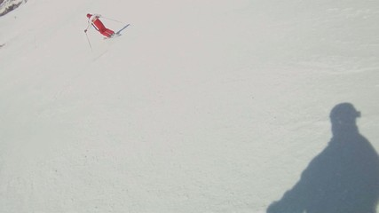 Athlete skiing down a mountain.