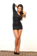 Full length hispanic fashion model in tight club dress