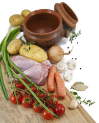 Ingredients for a roast chicken in a pot : chicken, potatoes, ca