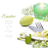 Fototapety Easter table setting with candle and flowers