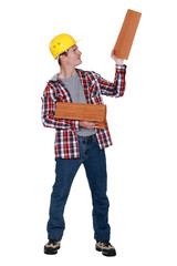 Roofer holding stack of tiles