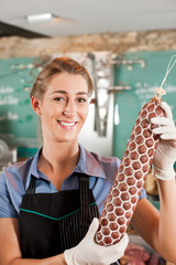 Female Butcher with Fresh Sausage