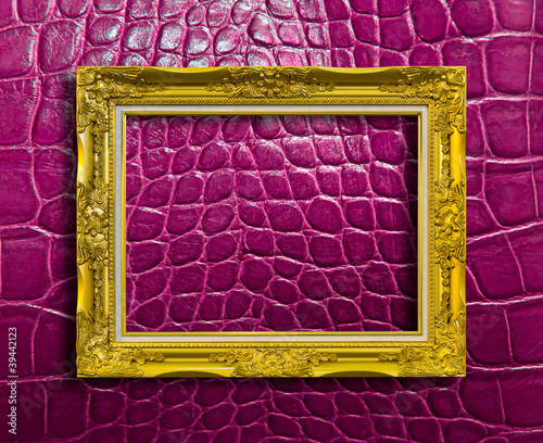 frame of golden wood on purple leather with clipping path
