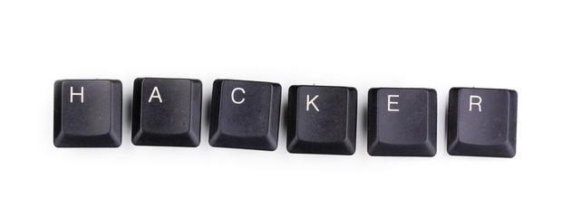 Keyboard keys saying hacker isolated on white