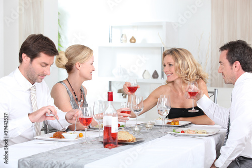 Two couples enjoying meal