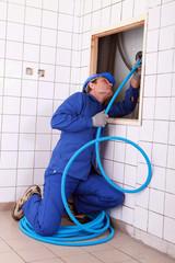craftsman repairing the pipes