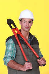 A construction worker holding pliers.
