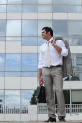 Man standing outside with his briefcase