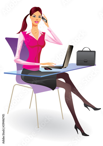 Business woman with laptop in a office