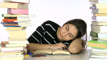 Girl falling asleep while studying