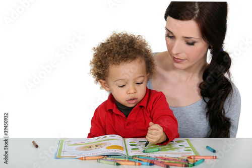 Mother and son coloring-in together