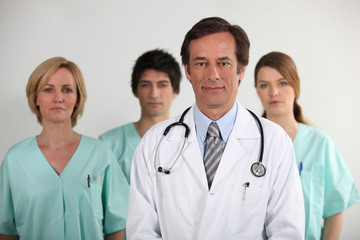 Male doctor and his nursing team
