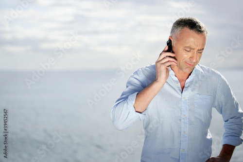 Man on the phone outdoors