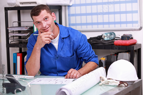 Manual worker looking at paperwork