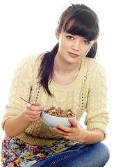 Young Woman Eating Breakfast Cereal. Model Released