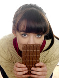Young Woman Eating Chocolate. Model Released