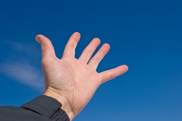 people hand on a blue sky background