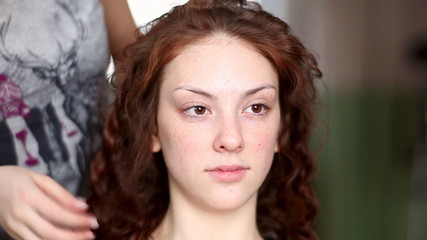 Model visage hairstyle for photography in studio. Rack focus.