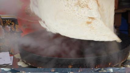 Women prepare pancakes