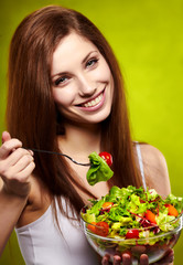 happy healthy woman with salad on green background