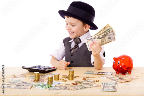 Boy at the table counts money