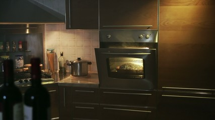 domestic kitchen with chicken in oven