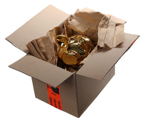 golden piggybank in cardboard box with brown paper