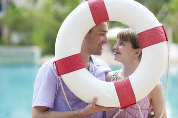 young couple with ring-buoy