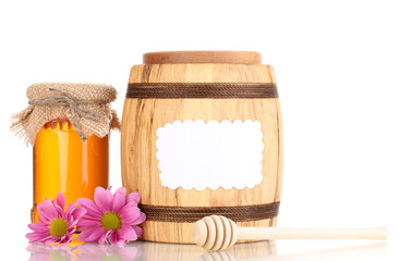 Sweet honey in jar and barrel with drizzler isolated on white