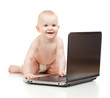 Cute baby using a laptop