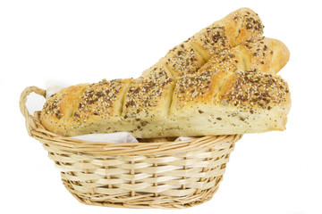 home made bread in wicker-basket isolated