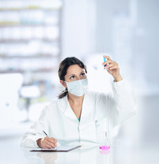 a young woman researcher working with chemicals