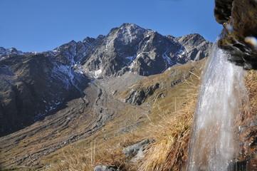 Cima di Pietra Rossa with small waterfall, Stelvio National Park