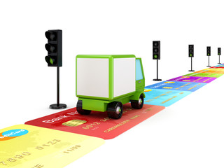 Green truck on a road made of credit cards.