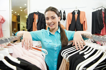 Woman seller consultant in clothes shopping store