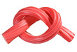 Red gummy candy (licorice) rope, isolated on white closeup view
